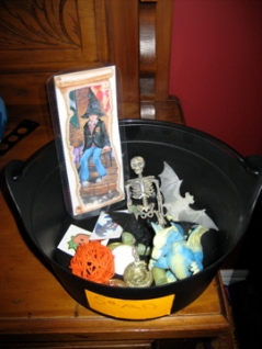 A laminated bookmark and other trinkets for their cauldrons