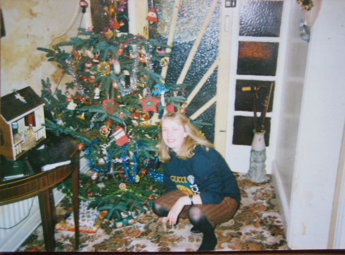 My sister Cathy in front of a tree and crib. Funny how I though the tree was huge as a child