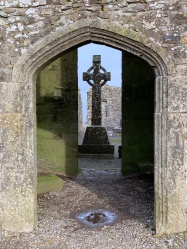 A celtic cross marks a grave inside the church