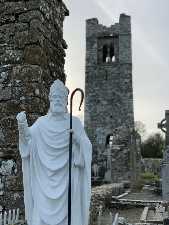 St.Patrick in front of the church tower
